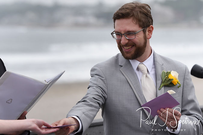 Justin hands Amber her vows during his June 2018 wedding ceremony at North Beach Clubhouse in Narragansett, Rhode Island.