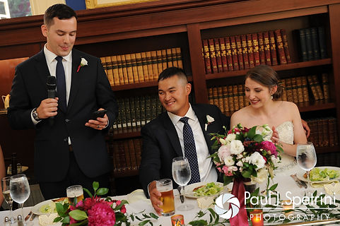Dan and Simonne listen to the best man's toast during their June 2016 wedding in Providence, Rhode Island.