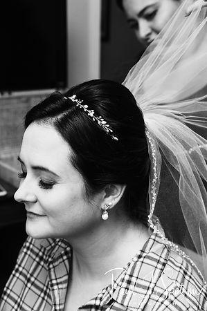 Justine has her veil put on prior to her October 2018 wedding ceremony at Twelve Acres in Smithfield, Rhode Island.