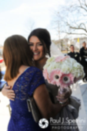 Maria receives a congratulatory hug following her March 2016 Rhode Island wedding at the Church of St. John the Baptist in Pawtucket, Rhode Island.