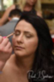 Stephanie has her makeup applied prior to her June 2018 wedding ceremony at Foster Country Club in Foster, Rhode Island.