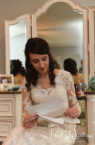 Stacey reads a letter from Mack during her bridal prep session at in Attleboro, Massachusetts.