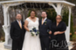 Gunnar and Aileen pose for a formal photo with members of their family following their December 2018 wedding ceremony at McGoverns on the Water in Fall River, Massachusetts.