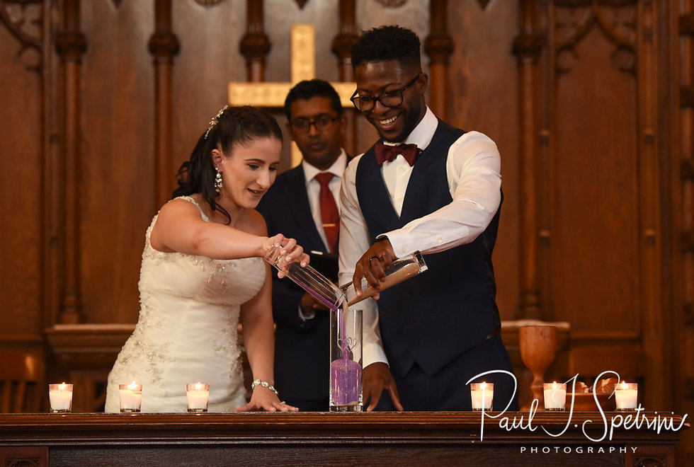 Courtnie and Richardson participate in a sand ceremony during their August 2018 wedding ceremony at Glad Tidings Church in Quincy, Massachusetts.