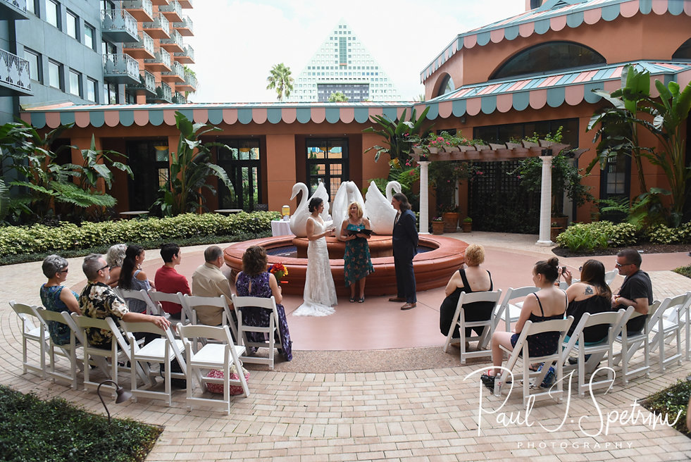 Amanda and Josh exchange vows during their October 2018 wedding ceremony at the Walt Disney World Swan & Dolphin Resort in Lake Buena Vista, Florida.