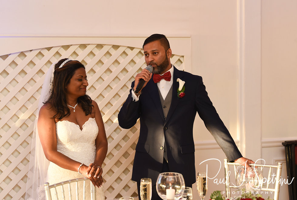 Jimmy and Saken thank guests during their July 2018 wedding ceremony at Lake Pearl in Wrentham, Massachusetts.