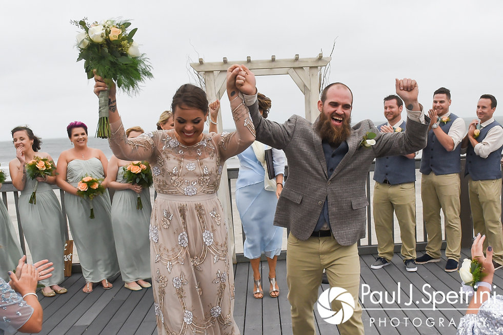 Arielle and Gary dance down the aisle following their September 2017 wedding ceremony at North Beach Club House in Narragansett, Rhode Island.