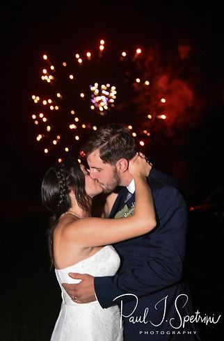 Karolyn & Ethan pose for a firework photo during their August 2018 wedding reception at a private residence in Sterling, Connecticut.