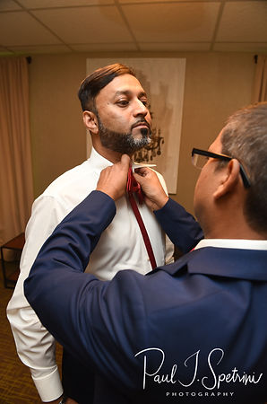 Jimmy has his tie put on prior to his July 2018 wedding ceremony at Lake Pearl in Wrentham, Massachusetts.