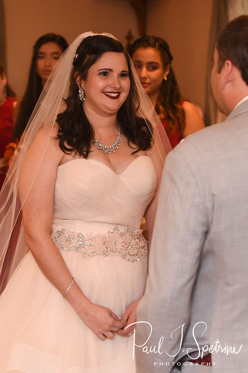 Makayla smiles during her October 2018 wedding ceremony at Zukas Hilltop Barn in Spencer, Massachusetts.