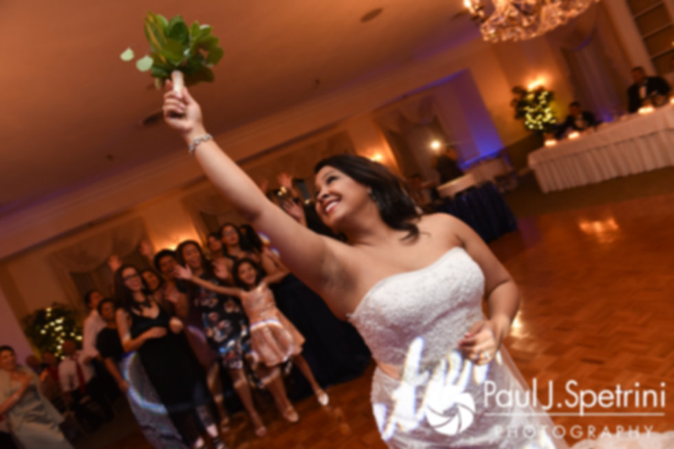 Stephany tosses the bouquet during her September 2017 wedding reception at Wannamoisett Country Club in Rumford, Rhode Island.
