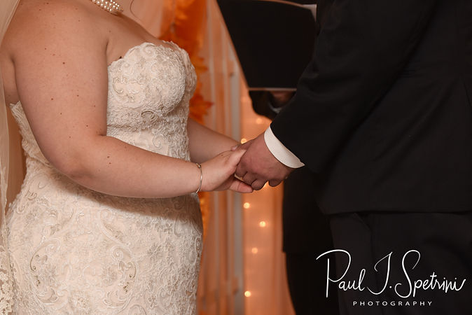 Chris and Stephanni hold hands during their October 2018 wedding reception at Rachel's Lakeside in Dartmouth, Massachusetts.