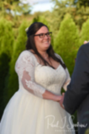 Katie looks at Steve during her October 2018 wedding ceremony at The Villa at Ridder Country Club in East Bridgewater, Massachusetts.