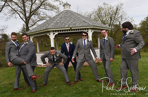 Gary poses for a photo with his groomsmen prior to his May 2018 wedding ceremony at the Roger Williams Park Botanical Center in Providence, Rhode Island.