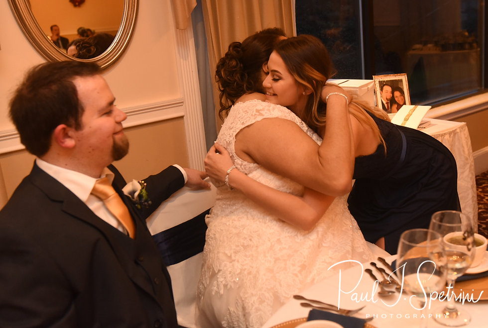 Aileen hugs her maid of honor during her December 2018 wedding reception at McGoverns on the Water in Fall River, Massachusetts.