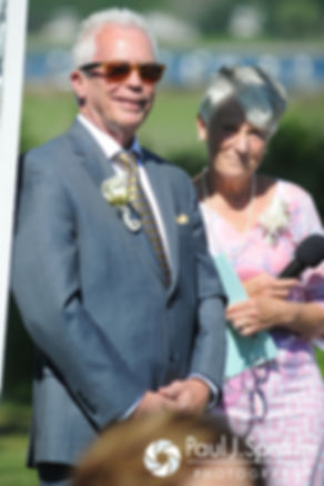 Bob smiles as her watches Debbie walk down the aisle during their June 2016 wedding in Barrington, Rhode Island.