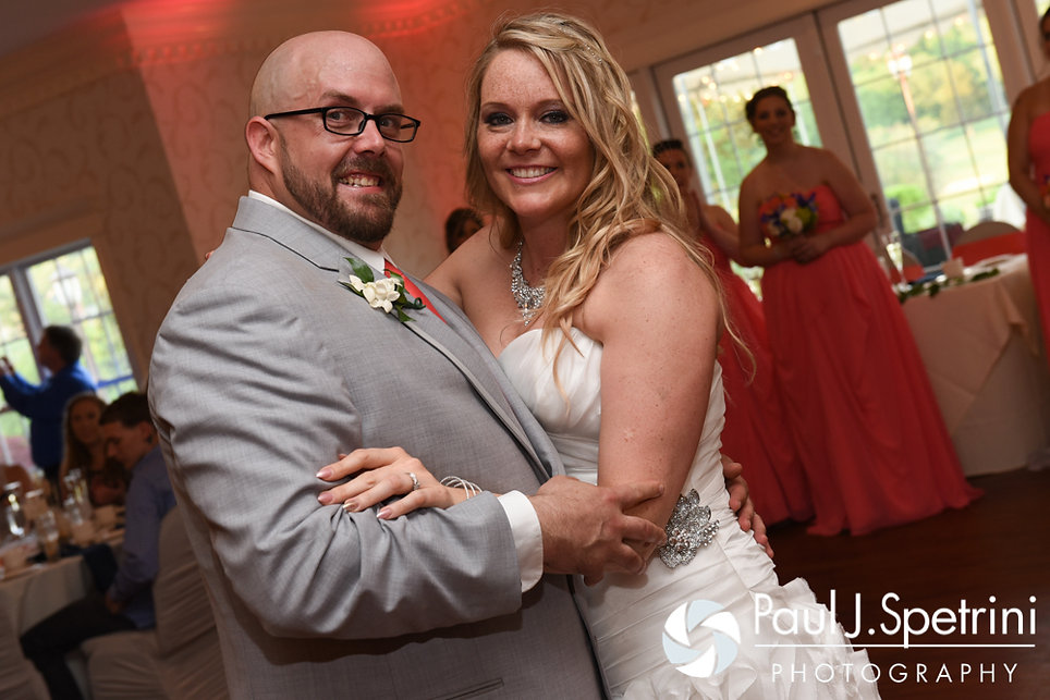 Michelle and Eric smile following their first dance during their May 2016 wedding at Hillside Country Club in Rehoboth, Massachusetts.