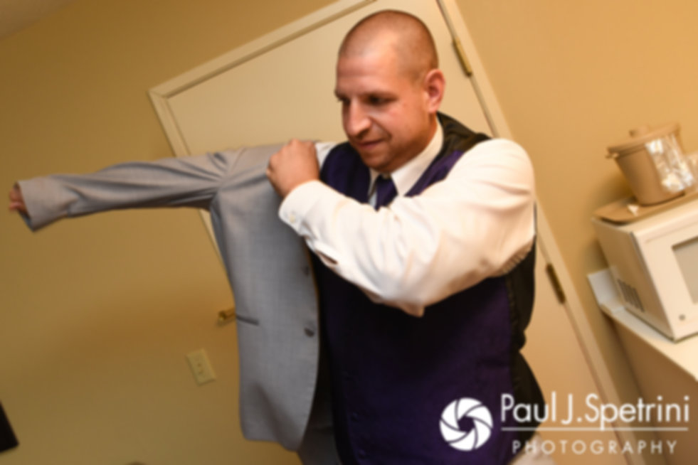 Kevin puts his jacket on prior to his September 2017 wedding ceremony at Allen Hill Farm in Brooklyn, Connecticut.
