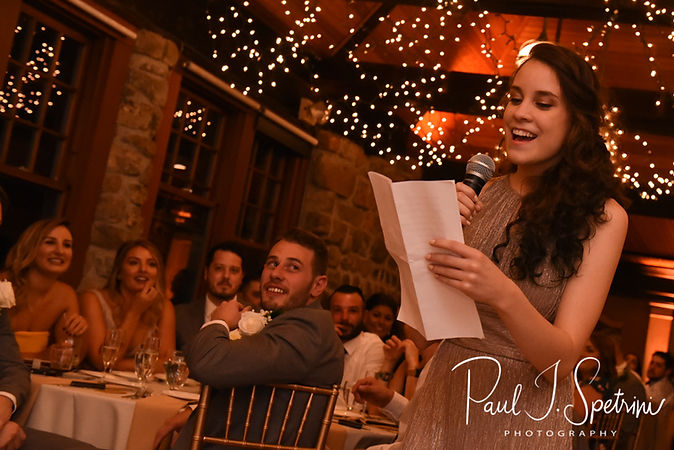 One of the maids of honor gives a toast during Nicole & Dan's September 2018 wedding reception at The Towers in Narragansett, Rhode Island.