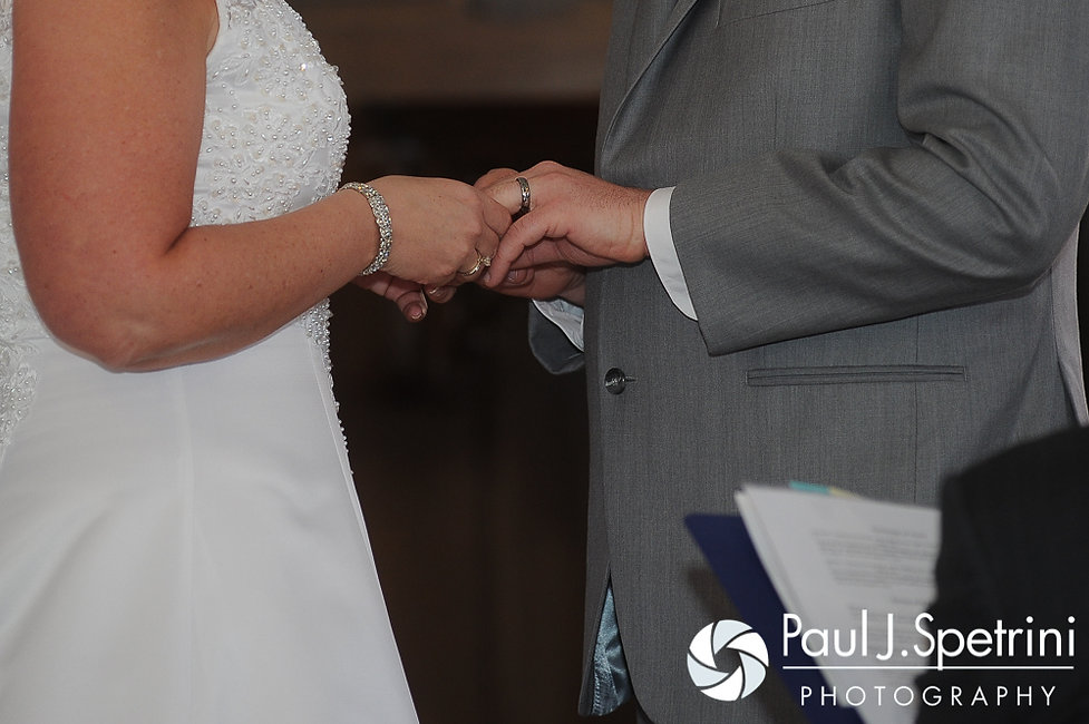 Angela and Shawn exchange rings at the Kay Chapel in Newport, Rhode Island during their spring 2016 Rhode Island wedding.