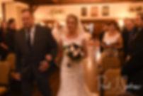 Nicole walks down the aisle during her November 2018 wedding ceremony at the Publick House Historic Inn in Sturbridge, Massachusetts.