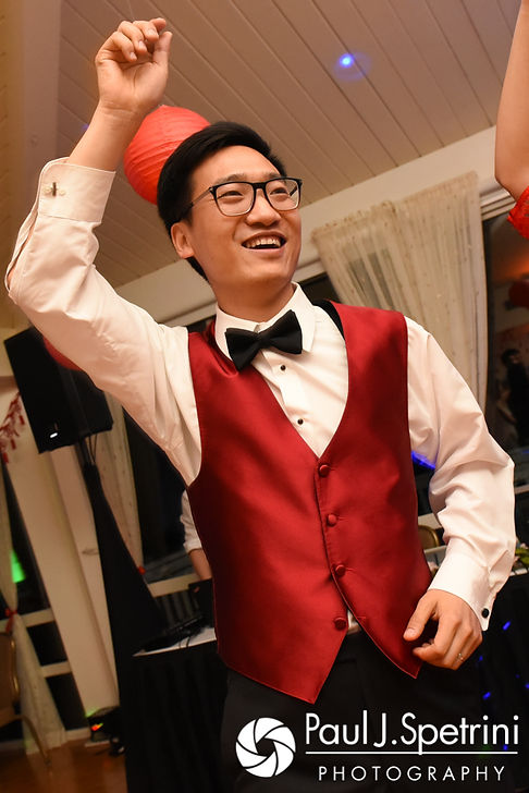 Ao dances during his August 2017 wedding reception at Lake Pearl in Wrentham, Massachusetts.