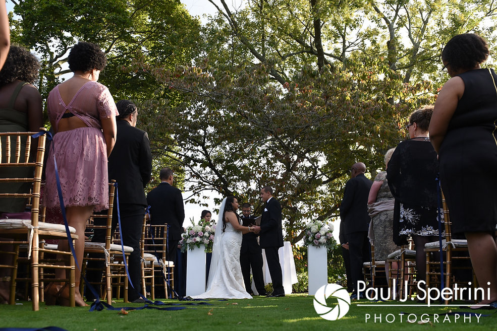 Arten and Stephany hold hands during their September 2017 wedding ceremony at Wannamoisett Country Club in Rumford, Rhode Island.