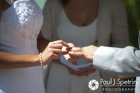 Heather and John exchange rings during their July 2016 wedding ceremony at Crystal Lake Golf Club in Burrillville, Rhode Island.