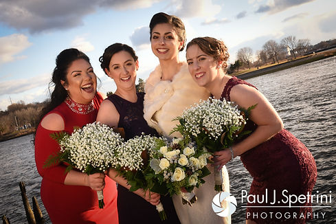 Gina poses for a photo with her bridesmaids prior to her December 2016 wedding ceremony at the Waterman Grille in Providence, Rhode Island.