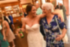 Danielle hugs a guest during her August 2018 wedding reception at the Roger Williams Park Casino in Providence, Rhode Island.