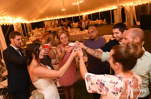 Karolyn and Ethan toast during their August 2018 wedding reception at a private residence in Sterling, Connecticut.