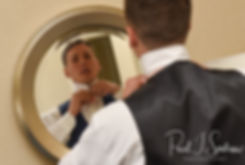 Michael adjusts his tie at the hotel prior to his August 2018 wedding ceremony at the Squantum Association in Riverside, Rhode Island.