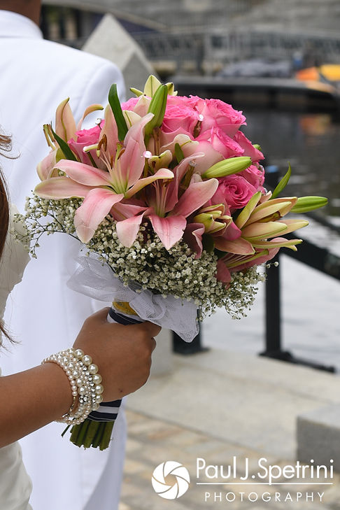 Lucelene holds her bouquet following her June 2017 wedding ceremony at Waterplace Park in Providence, Rhode Island.