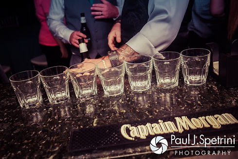 A row of shot glasses on display during Marissa and Paul's September 2016 wedding reception at the Aqua Blue Hotel in Narragansett, Rhode Island.