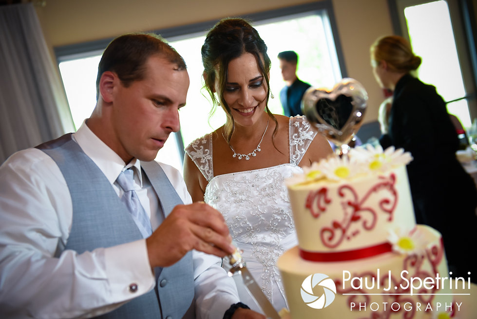 Heather and John cut the cake during their July 2016 wedding reception at Crystal Lake Golf Club in Burrillville, Rhode Island.