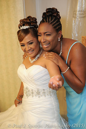 Jean Andrade and her matron-of-honor share a moment on her wedding day.
