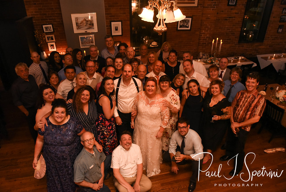 Patti & Bob pose for a photo with their wedding guests during their August 2018 wedding reception at the Olde Colonial Cafe in Norwood, Massachusetts.