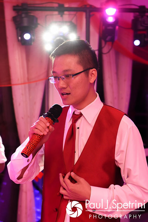 Wedding guests perform karaoke during Cynthia and Ao's August 2017 wedding reception at Lake Pearl in Wrentham, Massachusetts.