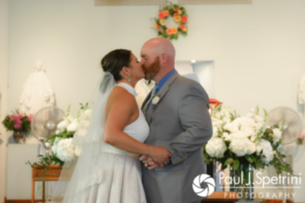 Molly and Tim share their first kiss as husband and wife during their June 2017 wedding ceremony at Saint Romuald Chapel in Matunuck, Rhode Island.