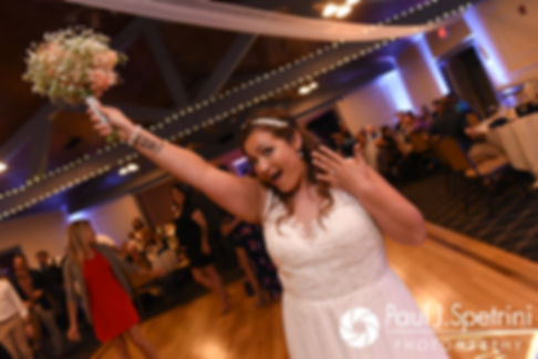 Toni gets ready to toss the bouquet during her August 2017 wedding reception at Crystal Lake Golf Club in Mapleville, Rhode Island.