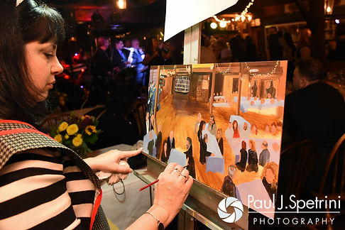 An artist paints a piece during Crystal and Andy's November 2016 wedding reception at the Salem Cross Inn in West Brookfield, Massachusetts.