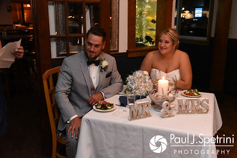 Jennifer and Robert listen to the maid of honor's toast during their September 2017 wedding reception at Oceanside at the Pier in Narragansett, Rhode Island.