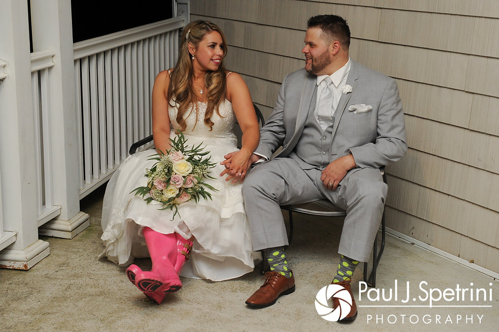 Nathan and Amy pose for a photo during their November 2017 wedding reception at Quidnessett Country Club in North Kingstown, Rhode Island.