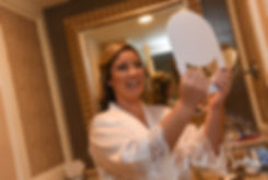 Sarah looks in the mirror during her bridal prep session at The Omni Hotel in Providence, Rhode Island prior to her October 2018 wedding.