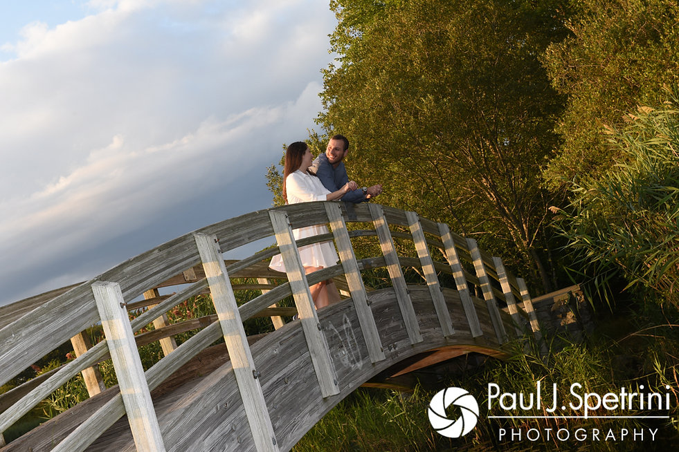 Jessica and Keiran pose candidly for a photo on a bridge at Ryan Park in North Kingstown, Rhode Island during their August 2017 engagement session.