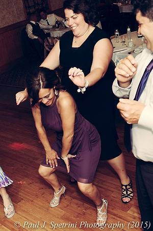 Wedding guests dance during Justin and Jamie Bolani's reception in June 2015 in Bristol, Rhode Island.