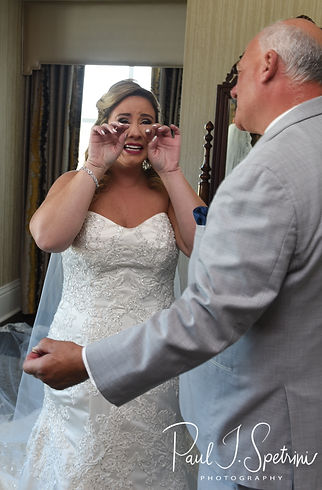 Sarah and her dad share a first look during her bridal prep session at The Omni Hotel in Providence, Rhode Island prior to her October 2018 wedding.
