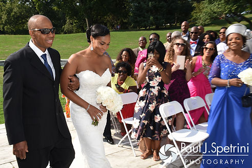 Jennifer walks down the aisle during her September 2016 wedding at the Roger Williams Park Temple of Music in Providence, Rhode Island.
