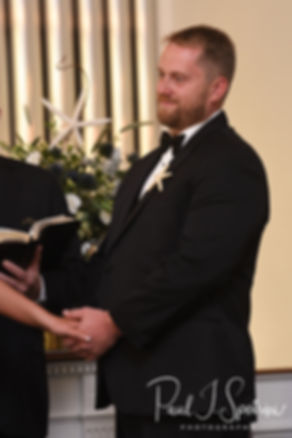Brandon smiles at Cara during his November 2018 wedding ceremony at First Baptist Church in Hope Valley, Rhode Island.