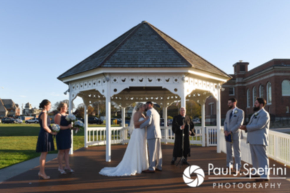Jennifer and Robert share their first kiss during their September 2017 wedding ceremony at Gazebo Park in Narragansett, Rhode Island.